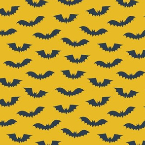 Halloween bats on yellow