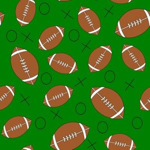 footballs on green