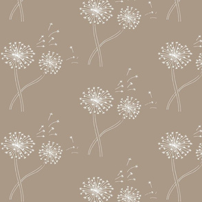 White dandelions floating on toffee background