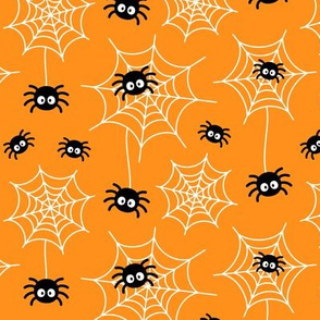 spiders and webs on orange » halloween