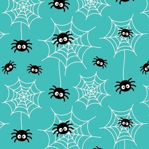 spiders and webs on teal blue » halloween