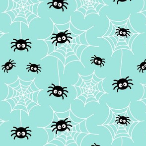spiders and webs on light baby teal blue » halloween