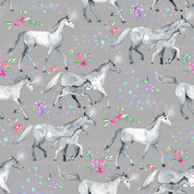 Mom and baby unicorns with stars on soft grey