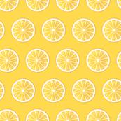Lemons on yellow background