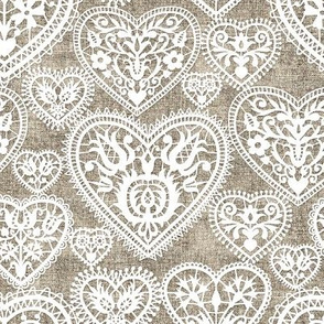 folk lace hearts on linen