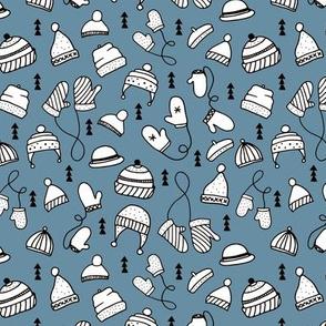 Ice cold winter season mittens and hats geometric kids illustration pattern design blue