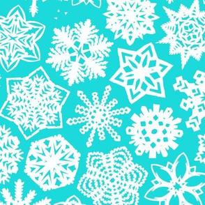 paper-cut snowflakes in aqua