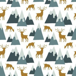 Alpine winter mountains with deer