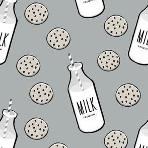 milk and cookies || milk jug on grey