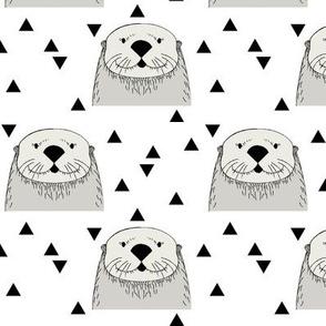 light grey otters on white