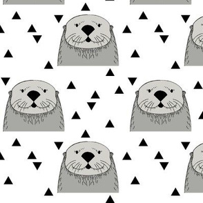 grey otters on white