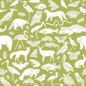 linocut animals // lime green botanical linocut fabric andrea lauren design andrea lauren fabric zoo animals zoo animal fabric