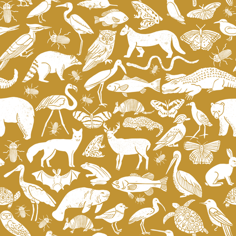 Linocut animals ochre mustard yellow fabric animals for Yellow nursery fabric