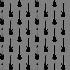 Black Electric Guitars on Medium Gray
