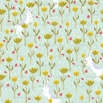 Snow  bunnies and flowers in pastel green