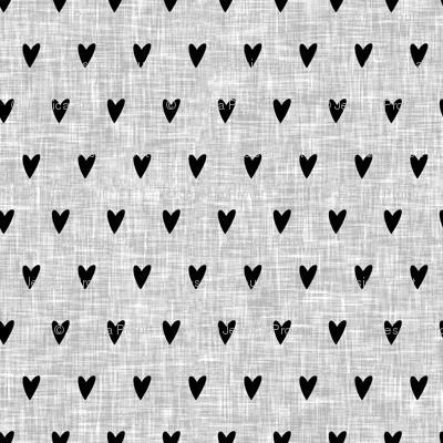 black hearts on light grey linen