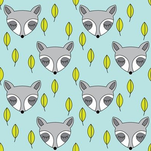 raccoons-sleeping-and-leaves-on-soft-blue
