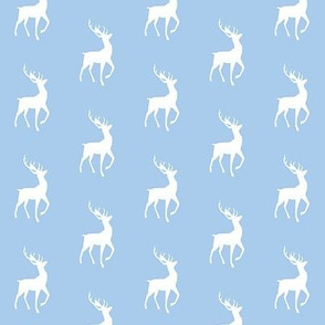 white deer on blue