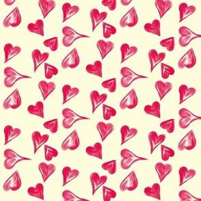 A Scatter of Crimson Hearts on Magnolia Cream