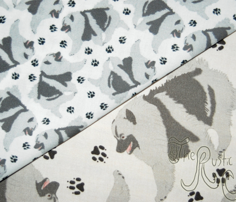 Trotting Keeshond and paw prints - tiny white