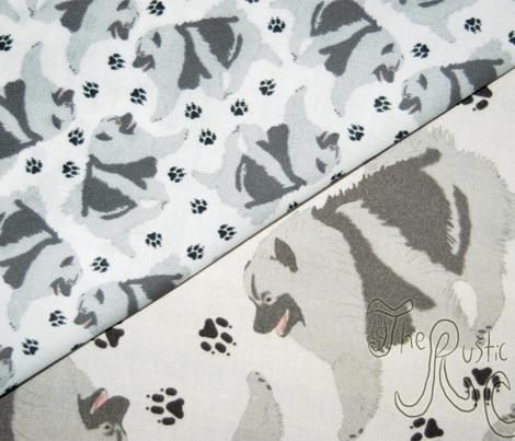 Trotting Keeshond and paw prints - tiny white