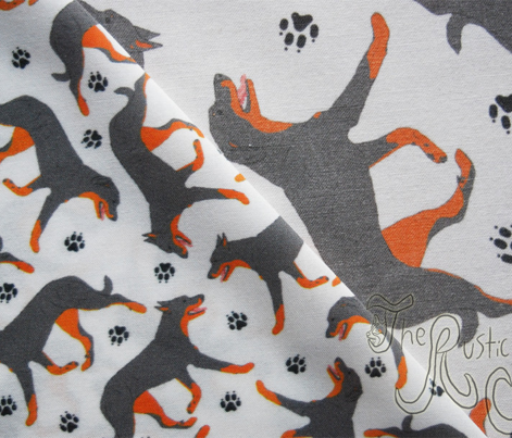 Trotting Beaucerons and paw prints - tiny white