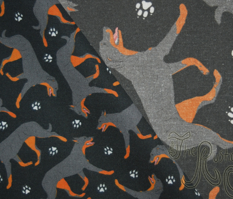 Trotting Beaucerons and paw prints - tiny black