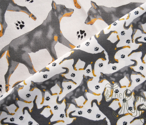 Trotting Beaucerons and paw prints B - tiny white