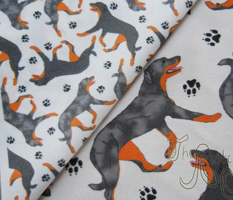 Trotting Beaucerons and paw prints C - tiny white