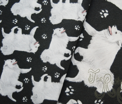 Trotting American Eskimo Dog and paw prints - tiny black