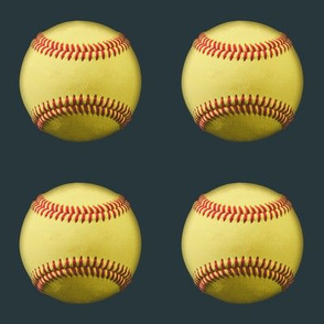 "3"" yellow softballs on dark grey"