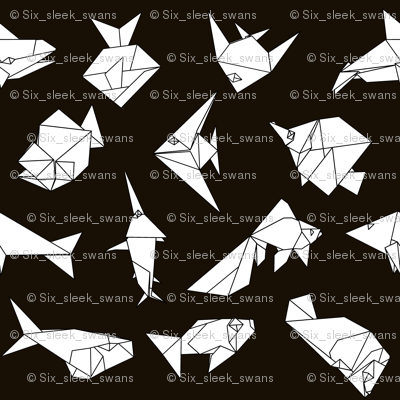 Origami fish folds on black