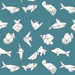 Origami fish folds on blue