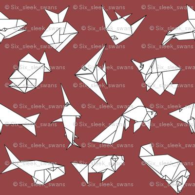 Origami fish folds on burgandy