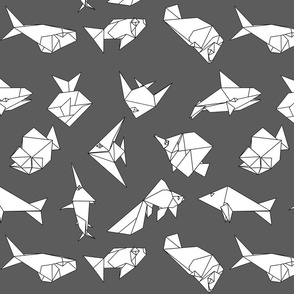 Origami fish folds on grey