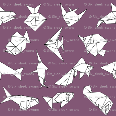 Origami fish folds on purple