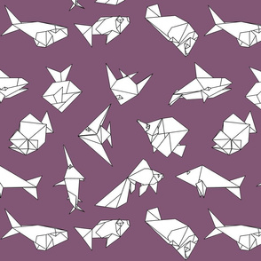 Origami fish folds on purple