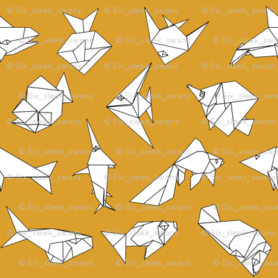 Origami fish folds on yellow