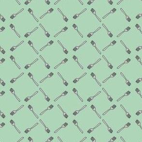 Forks on green background