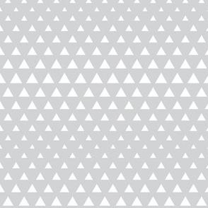 halftone triangles light grey reversed