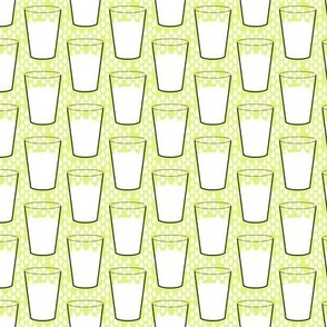Milk glasses on yellow
