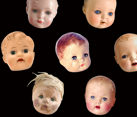 Decapitated Doll Heads - large black fabric by rawbonestudio on Spoonflower - custom fabric