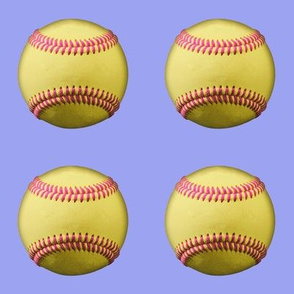 Yellow softballs with pink stitching, on lavender blue