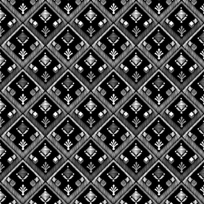 Black and white pattern . Embroidery . Black background .