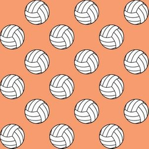 One Inch Black and White Volleyballs on Peach