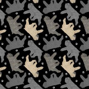 Trotting Bouvier des Flandres and paw prints - black