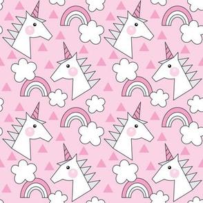 small unicorn-heads-on-hot-pink