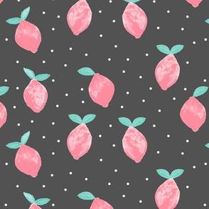 so fresh pink lemons on dark grey