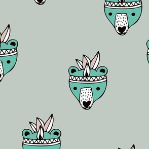 Woodland warrior grizzly bears indian summer animal feathers illustration for kids in mint green