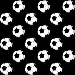 One Inch Black and White Soccer Balls on Black
